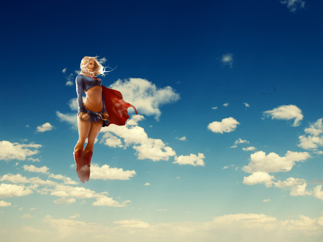Supergirl Flying In The Sky 壁紙画像